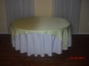 Round table with yellow linen